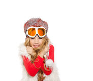 Kid girl with snow winter glasses and white fur Stock Image