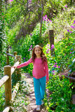 Kid girl in spring track in Cuenca forest of Spain Royalty Free Stock Photos