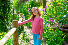 Kid girl in spring track in Cuenca forest of Spain. With wooden fence royalty free stock image