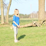 Kid - girl standing on meadow Royalty Free Stock Photography