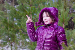 Kid girl surprised pointing finger pine forest Royalty Free Stock Images
