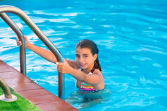 Kid girl in swimming pool at summer vacation Stock Images