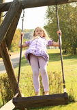 Kid - girl on swing Royalty Free Stock Image