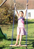 Kid - girl on swing Royalty Free Stock Photos