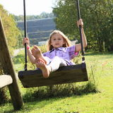 Kid - girl on swing Royalty Free Stock Images