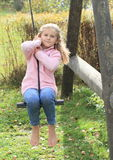Kid - girl on swing Stock Photos