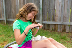 Kid girl taking photos to puppy dog with camera Royalty Free Stock Photography