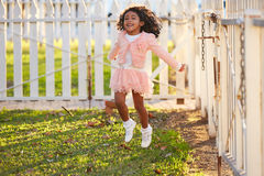 Kid girl toddler playing jumping in park outdoor Royalty Free Stock Images