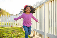 Kid girl toddler playing running in park outdoor. Latin ethnicity royalty free stock photo