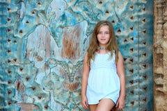 Kid girl tourist in Mediterranean old town door Royalty Free Stock Photos