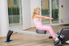 Kid girl training in the gym Royalty Free Stock Photo