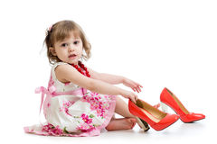 Kid girl trying on mummy's shoes Stock Photos