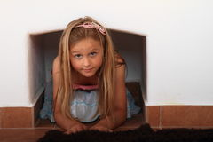 Kid - girl under the furnace Royalty Free Stock Images