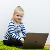 Kid girl using laptop Stock Photography