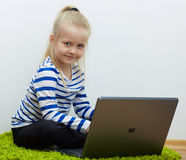 Kid girl using laptop Royalty Free Stock Photography