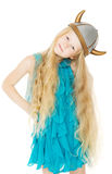 Kid girl in viking helmet with long hair Stock Image