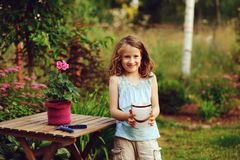 Kid girl walking with candle holder in romantic evening garden Stock Images