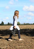 Kid - girl walking on field Stock Image