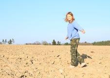 Kid - girl walking on field royalty free stock image