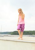 Kid - girl walking on roof Stock Photography