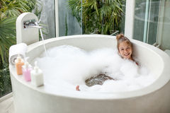 Kid girl washing in bath Royalty Free Stock Photos