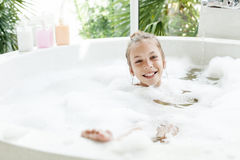Kid girl washing in bath Royalty Free Stock Image