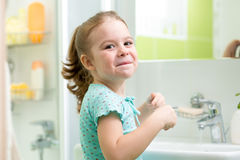 Kid girl washing his face and hands Royalty Free Stock Photos