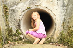 Kid - girl watching from sluice-way Stock Images