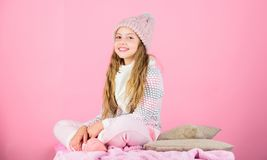 Kid girl wear knitted soft hat pink background. Keep knitwear soft after washing. Soft knitted accessory. Tips for. Caring for knitted garments. Child long hair stock photos