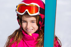 Kid girl winter snow portrait with ski equipment Stock Image