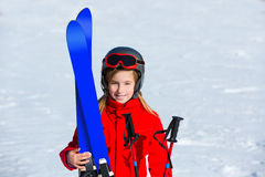 Kid girl winter snow with ski equipment Stock Photos