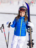 Kid girl winter snow with ski equipment Royalty Free Stock Photography
