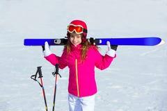 Kid girl winter snow with ski equipment Royalty Free Stock Image