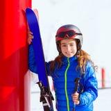 Kid girl winter snow with ski equipment Stock Photo