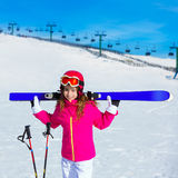 Kid girl winter snow with ski equipment Royalty Free Stock Images