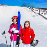 Kid girls sister in winter snow with ski equipment Royalty Free Stock Photos
