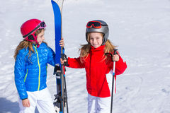 Kid girls sister in winter snow with ski equipment Stock Image