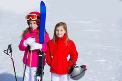 Kid girls sister in winter snow with ski equipment Stock Photo
