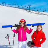 Kid girls sister in winter snow with ski equipment Royalty Free Stock Image