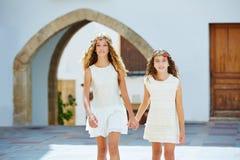 Kid girls walking hand in hand Mediterranean village Royalty Free Stock Images