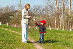 Kid give flower. Little boy give flower to mom Stock Photography