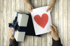 Kid gives greeting card and gift box Royalty Free Stock Photo
