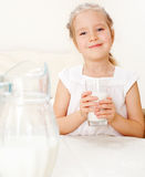 Kid with glass pitcher milk Stock Photo