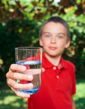 Kid with glass of water Royalty Free Stock Image