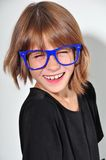 Kid with glasses having fun Royalty Free Stock Photography