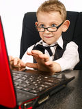 Kid in glasses and laptop Royalty Free Stock Image
