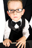 Kid in glasses and laptop Royalty Free Stock Photo