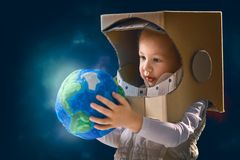 Kid with globe royalty free stock photography