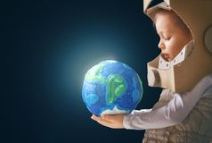 Kid with globe. Child is dressed in an astronaut costume. Kid with globe. Earth day stock photography