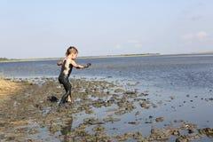 Kid goes on healing mud Royalty Free Stock Photos